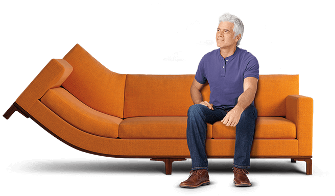 A man sitting on a curved couch